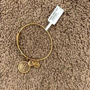 Gold H Alex and Ani bracelet